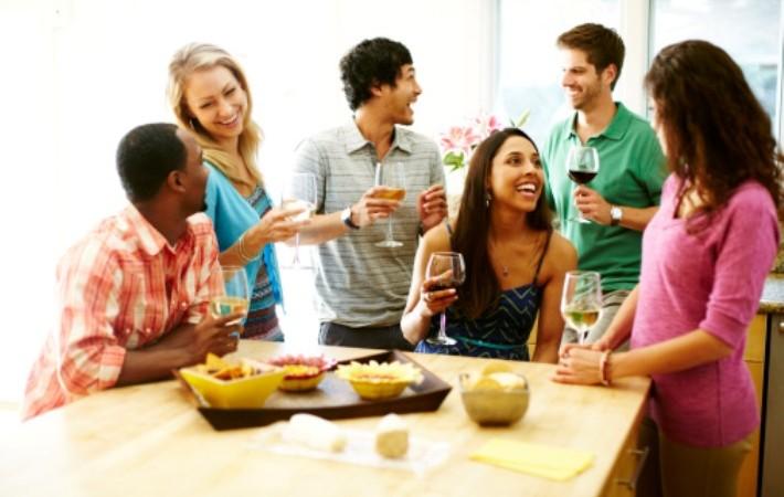 Friends enjoying wine together.